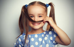 Happy face funny child girl in blue Royalty Free Stock Photo