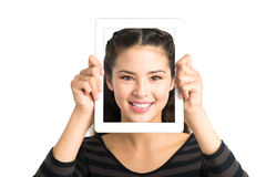 Happy face in gadget Royalty Free Stock Photo