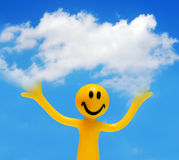 A happy face holding a cloud. A happy face holding a white cloud. Conceptual, copyspace Royalty Free Stock Photography