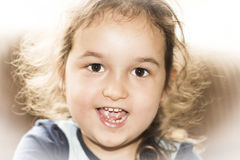Happy face little girl smiling. Little girl smiling and looking directly the camera Stock Images