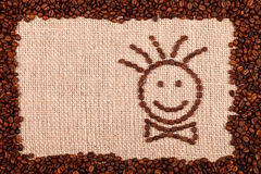 Happy face made of coffee beans Stock Photos