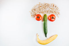Happy face made with fresh fruits. Tomato, cucumber , banana, pu Stock Photography