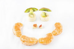 Happy face made with fruits. Royalty Free Stock Photography