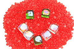 Happy face, made of glass beads Royalty Free Stock Photography