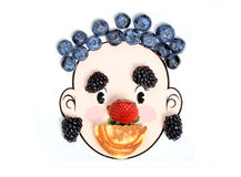Happy face made withberries and pancake. Royalty Free Stock Photos