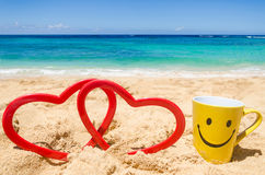 Happy face mug on the beach Royalty Free Stock Image