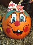 Happy face painted pumpkin Stock Photos