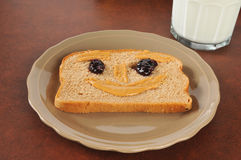 Happy face peanut butter sandwich Stock Photos