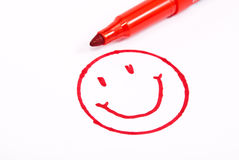 Happy face with pencil. On white Royalty Free Stock Image