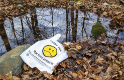 Happy Face is sad on plastic bag that was not recycled. Sad 'happy face' on a plastic bag that wound up in a pond in the woods Stock Photos