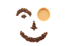 Happy face shaped of coffee beans with cup Stock Images