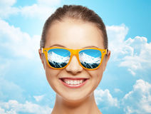 Happy face of teenage girl in sunglasses Royalty Free Stock Photography