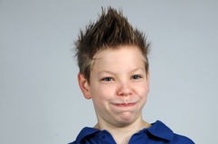 Happy face. Happy teenager with punk hairstyle Stock Photos