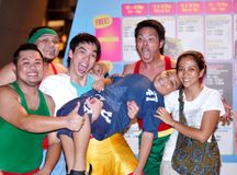 Happy Faces. During the Singapore Arts Festival, the comedy group Cardio Boys went through with their comic routines to the delight of the Marina Promenade crowd Royalty Free Stock Photo