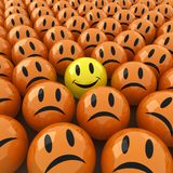 Happy faces. 3d computer generated  image of a lot of sad face around an happy one Stock Photography