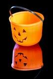 Happy faces plastic jack lantern for Halloween Stock Image
