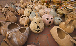 Happy faces pumpkin pottery Royalty Free Stock Photography