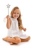 Happy fairy doing her magic Stock Image
