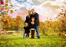 Happy Fall Family Outside with Leaves Royalty Free Stock Image