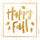 Happy Fall - hand drawn lettering with leaves on wooden background stock illustration