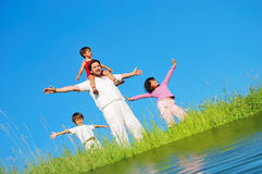 Happy famili, meadow, river Stock Images