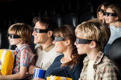 Happy Families Watching 3D Movie In Theater Stock Photos
