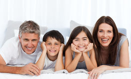 Happy familly looking at the camera Stock Images