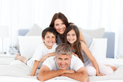 Happy familly looking at the camera Stock Image