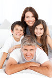 Happy familly looking at the camera royalty free stock image