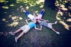 Happy familly lying down in the park Stock Images