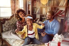 Happy family – mother, father and little daughter playing toge stock images
