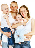 Happy family. With two kids royalty free stock photography