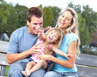 Happy family. Father, mother and daughter in the park Royalty Free Stock Photos