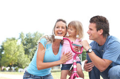 Happy family. Father, mother and daughter in the park Royalty Free Stock Photography