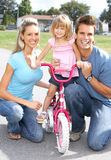 Happy family. Father, mother and daughter in the park Royalty Free Stock Photo