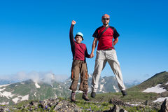 Happy family. In Caucasus mountains Royalty Free Stock Photos