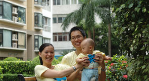 Happy family. Happy chinese family photo, father,mother and baby Stock Photography
