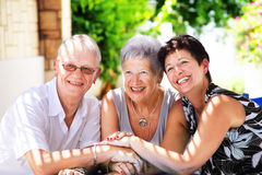 Happy family. Close-up of a happy family sitting close together joining hands Stock Photos