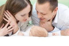 Happy family. At home: mother, father, little baby and happiness royalty free stock image
