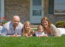 Happy Family. Family in Their Front Yard Stock Photo