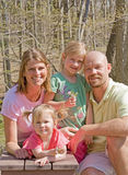 Happy Family. Attractive Family of Four at the Park Stock Image