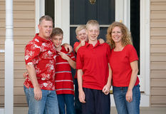 Happy Family. In Front of Their Home Stock Photos