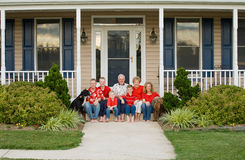 Happy Family. In Front of Their Home Stock Photo