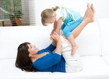 Happy family. Mother and daughter having fun at home stock image