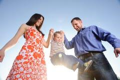 Happy family. Isolated on blue sky Stock Photo