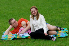 The happy family. On the grass in garden stock image