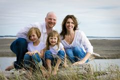 Happy Family. A happy family of four at the beach Royalty Free Stock Image