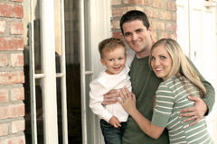 Happy Family. A young happy family standing outside a home Stock Photos