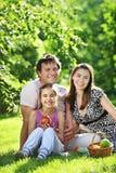 Happy family. Having picnic in summer park stock photo