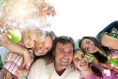 Happy family. Having fun in summer park stock photos